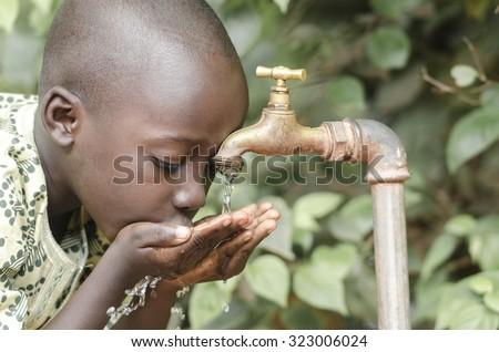 African Black Boy Drinking Fresh Clean Water - stock photo