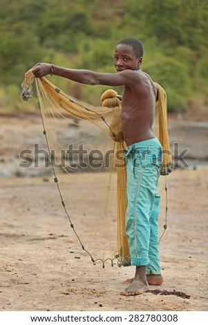 african boy fisherman - stock photo