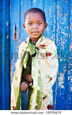 african boy living in a very poor community in a village near Kalahari desert
