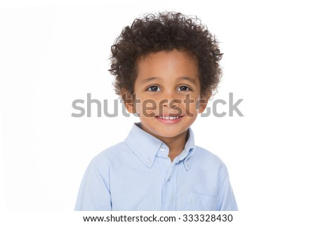 african boy smiling and posing on white background - stock photo