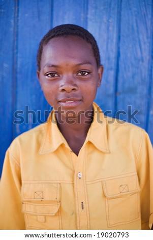 african boy with yellow shirt, in a village near Kalahari desert - stock photo