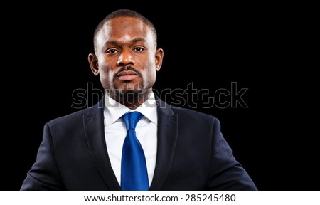 African business man isolated on black - stock photo