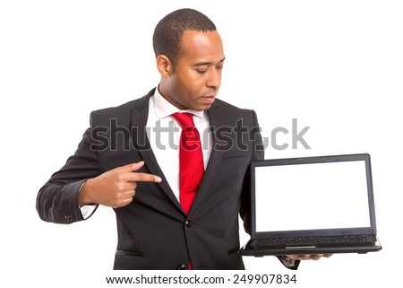 African business man presenting your product in a laptopcomputer - stock photo