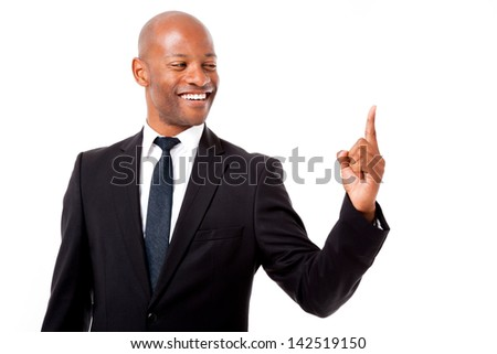 African business man with the world at his fingertips shot on an isolated background - stock photo