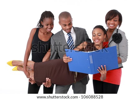 African business men and women holding up a colleague to show support in the working environment. - stock photo