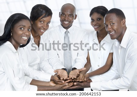 African business team presenting with open hands, Studio Shot
