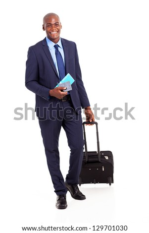 african business traveller with trolley bag and air ticket - stock photo