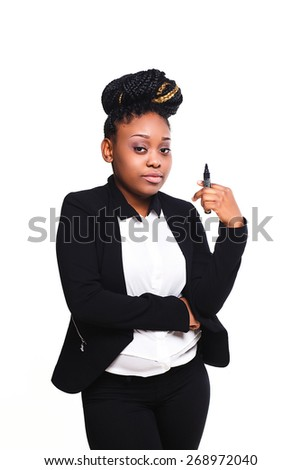African business woman writes a marker - stock photo