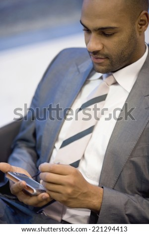 African businessman holding electronic organizer