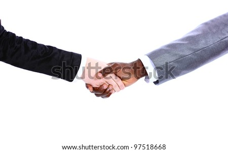 African businessman's hand shaking white businesswoman's hand