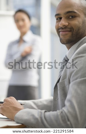 African businessman sitting at table - stock photo