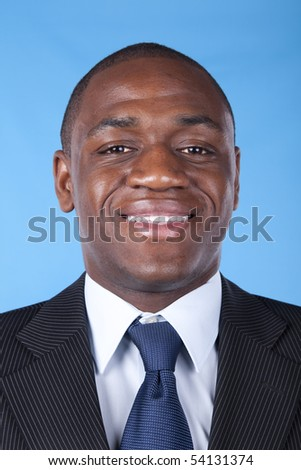 African businessman smiling with a blue background