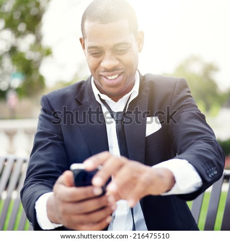 african businessman taking selfie with smartphone - stock photo