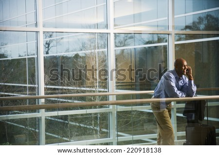 African businessman talking on cell phone - stock photo