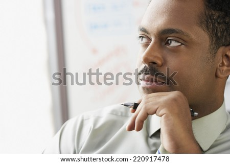 African businessman thinking - stock photo