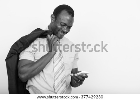 African businessman using mobile phone - stock photo