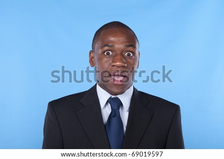 african businessman with a surprised expression - stock photo