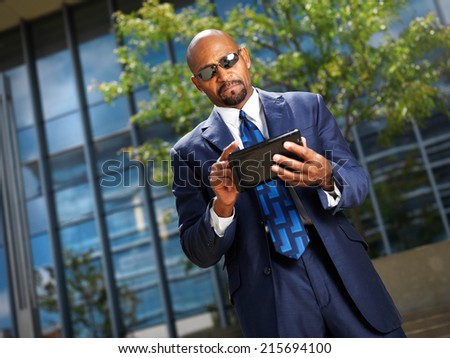 african businessman working on tablet - stock photo