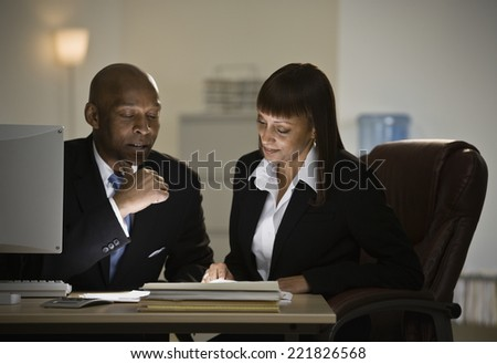 African businesspeople looking at paperwork - stock photo