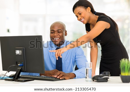 african businesspeople working at the office on a computer - stock photo