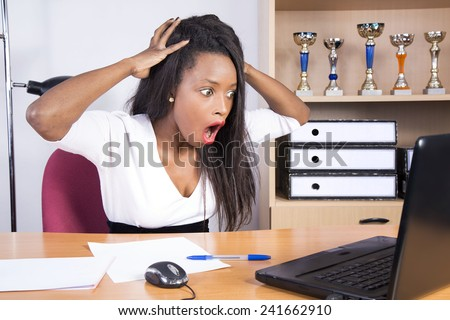 african businesswoman surprised angry in the office - stock photo