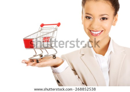 African businesswoman with shopping cart. - stock photo