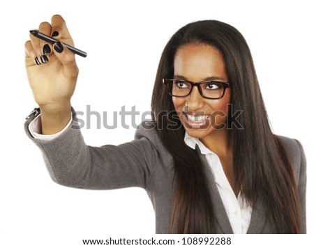 African Businesswoman writing or drawing with pen on copy space - stock photo