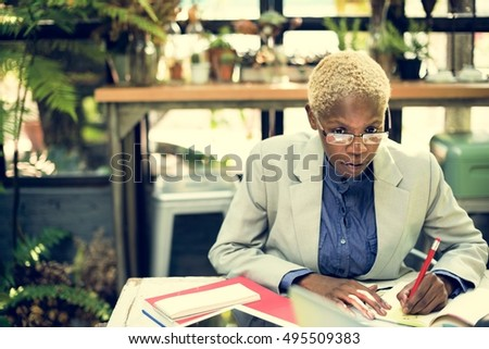 African Businesswoman Writing Paperwork Planning Strategy Working Concept