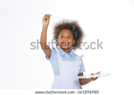 african child drawing with a brush - stock photo