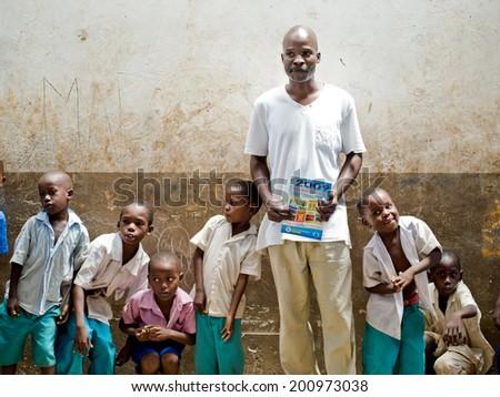 African children teacher in school. Kenya. Mombasa. January 25, 2012 - stock photo