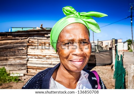 african colored woman wearing a lime green head wrap - stock photo