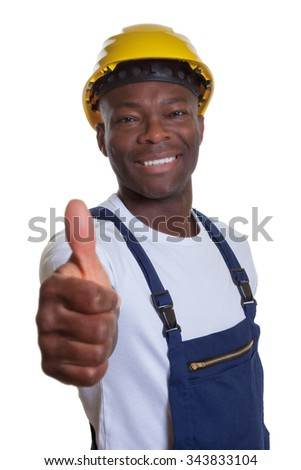 African construction worker showing thumb up - stock photo