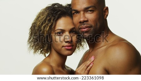 African couple standing and looking at camera - stock photo