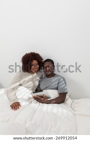 african couple using the computer - stock photo