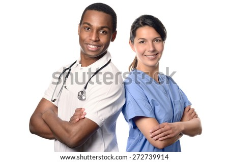 African doctor with a smiling happy Caucasian nurse or medical colleague standing back to back with folded arms isolated on white, upper body portrait conceptual of healthcare - stock photo