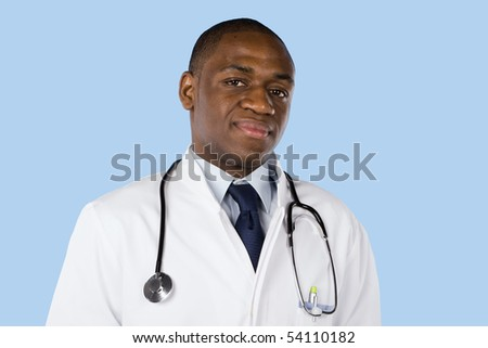 African doctor with a stethoscope around his neck isolated on blue - stock photo