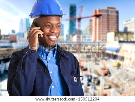 African engineer at phone  - stock photo