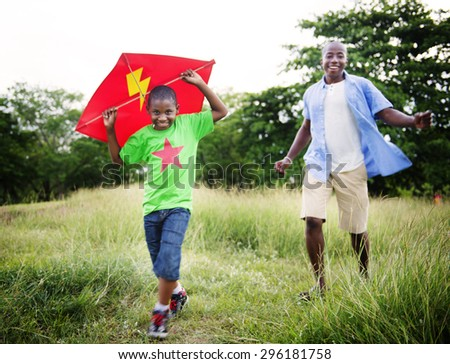 African Family Happiness Holiday Vacation Activity Concept - stock photo