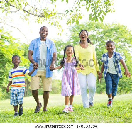 African Family Having Fun in The Park - stock photo