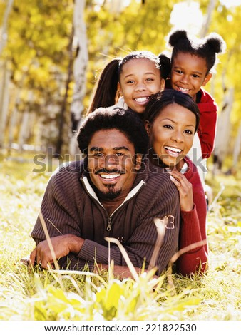 African family laying in grass - stock photo
