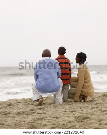 African family looking at ocean - stock photo