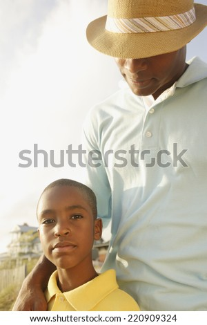 African father and son at beach - stock photo
