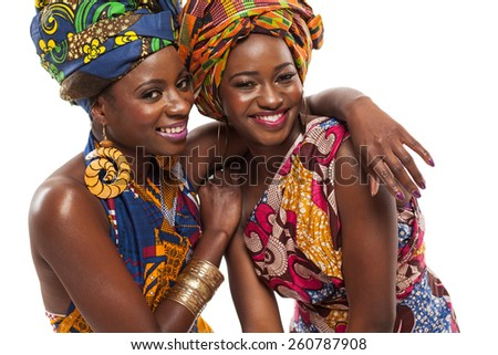 African female models posing in colorful dresses. - stock photo