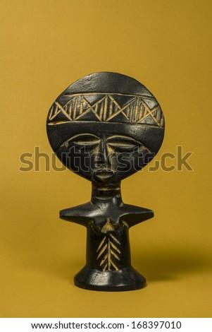 African Fertility Wooden Statuette Vertical Photo - stock photo