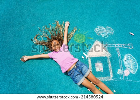 African girl and her chalk paiting - stock photo