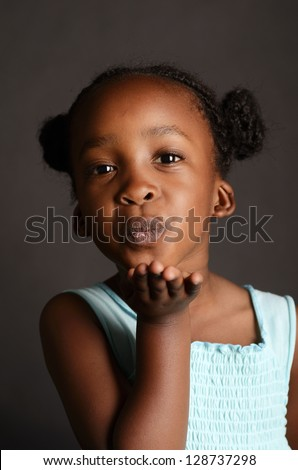 African girl blowing a kiss - stock photo