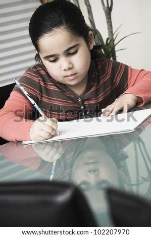 African girl doing homework