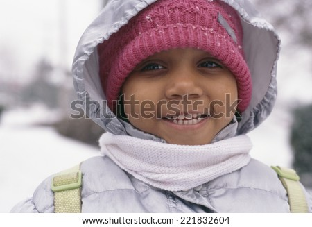 African girl in winter clothing - stock photo