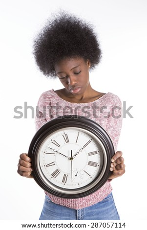 African girl with a clock - stock photo