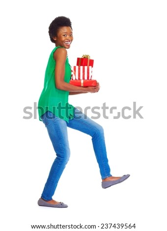 African girl with Christmas gifts isolated white background - stock photo